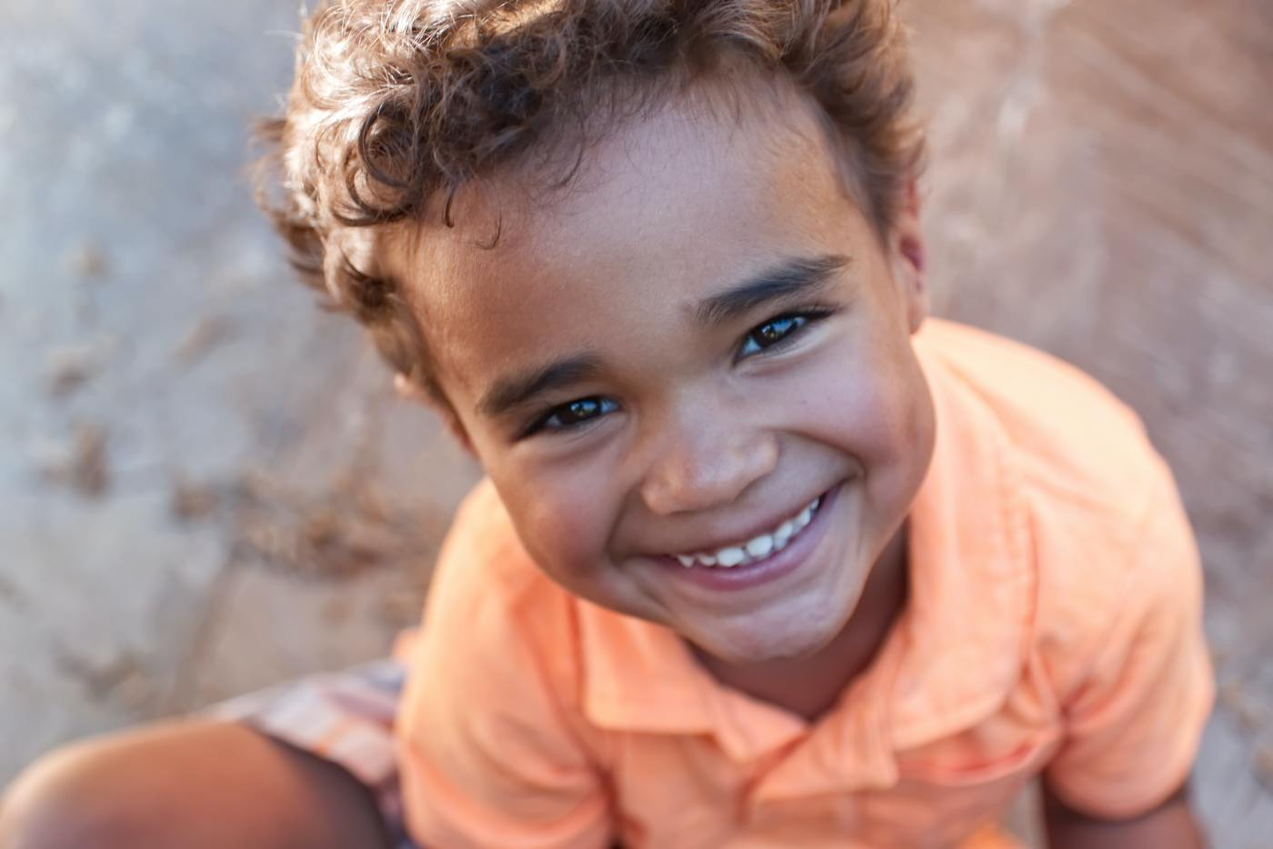 Young boy portrait in summer sunset