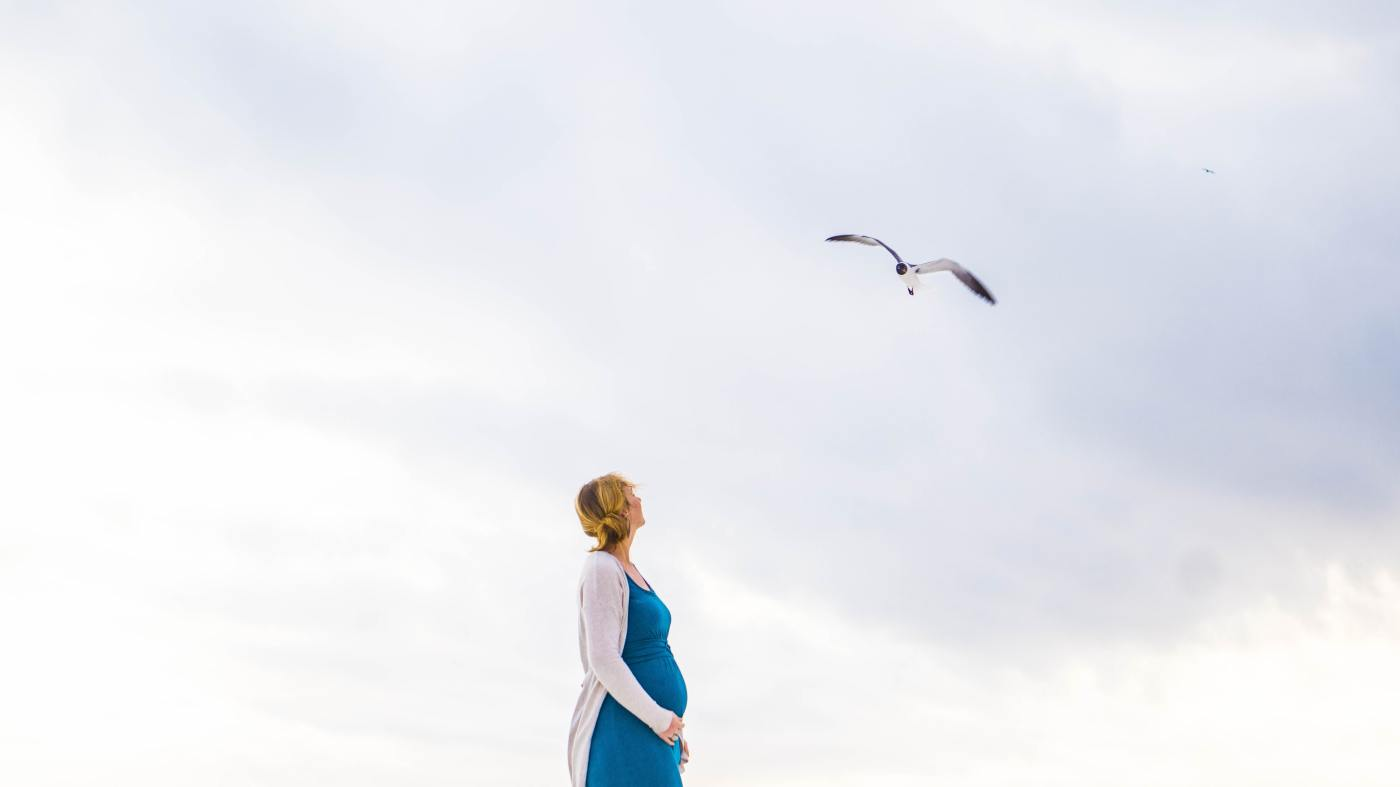 Lady with Baby bump looking at sky