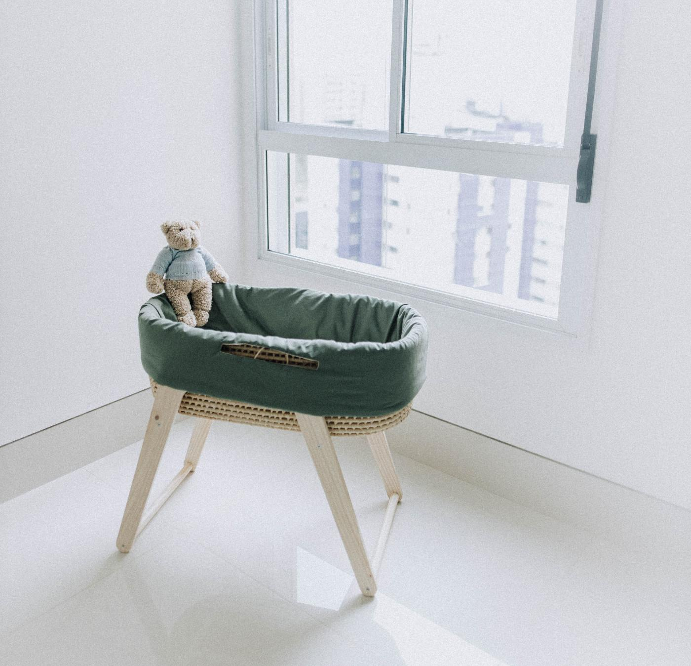 Baby doll in a cradle