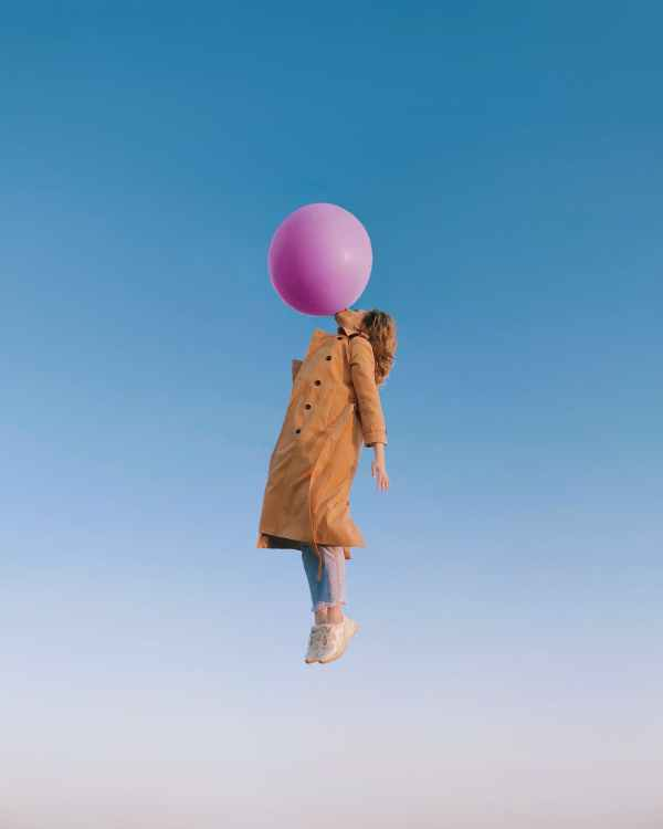 Girl with bubble gum flying high