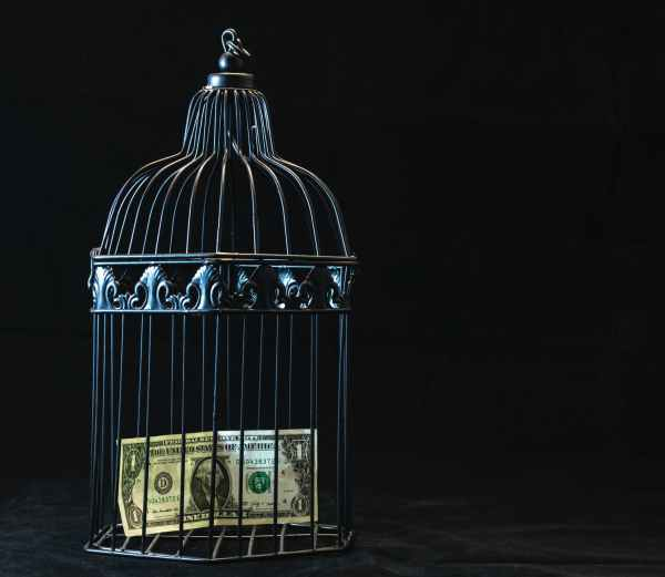 Cash inside the cage